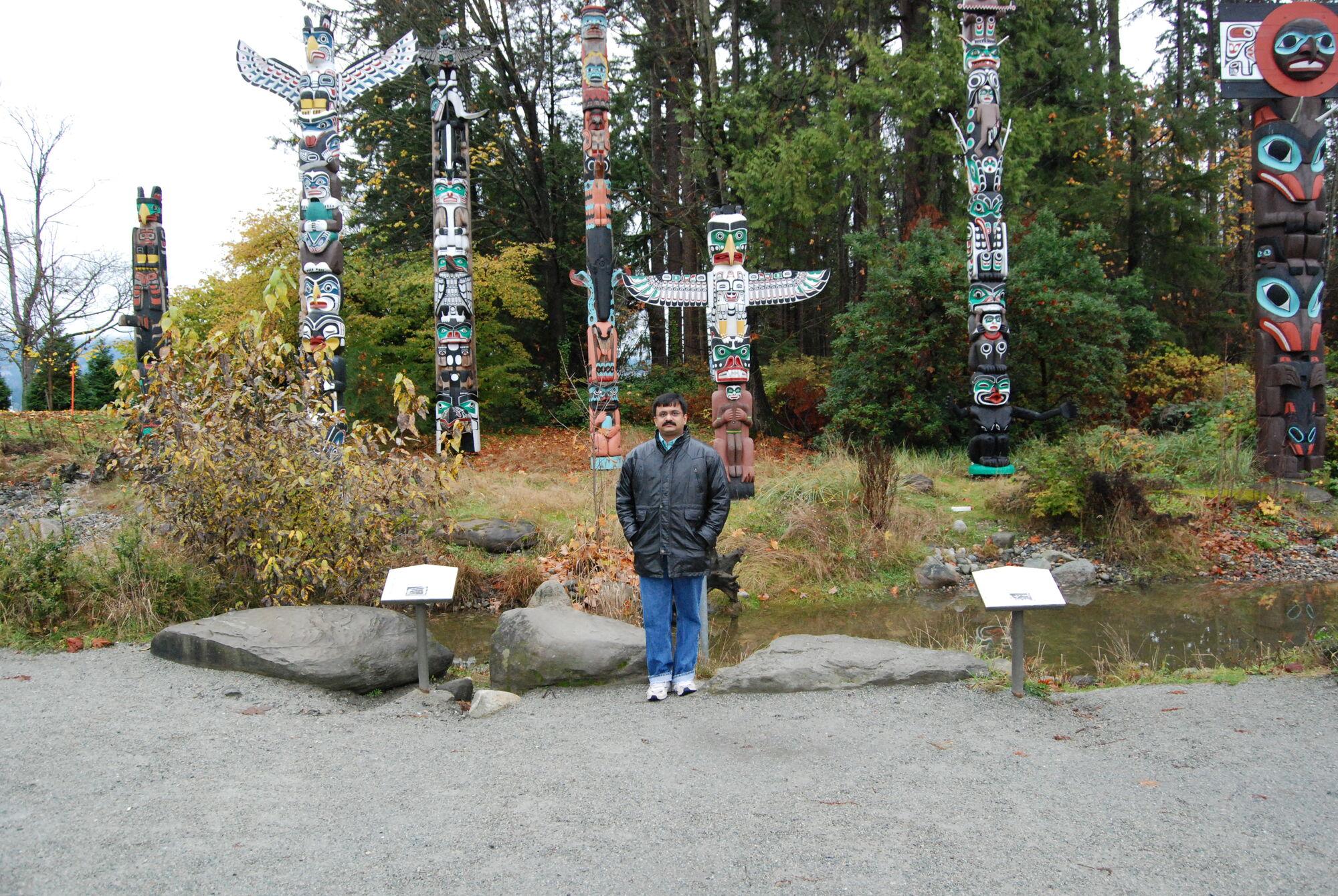 Venkatarangan in front of Totem Poles at Stanley Park