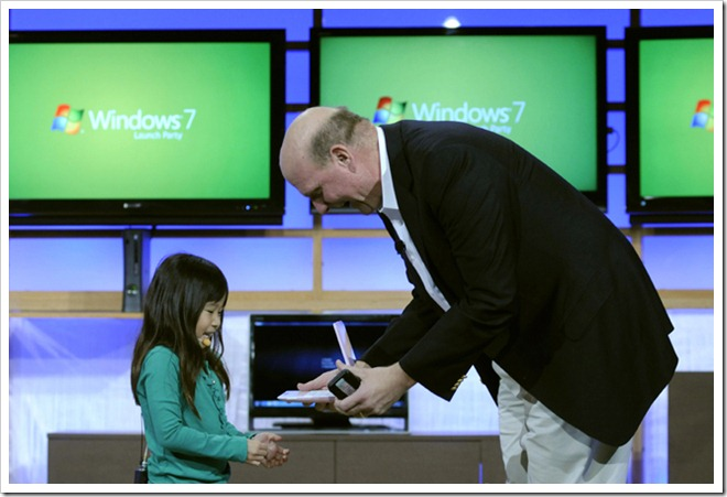 Kylie, from the Windows ads, and Microsoft CEO Steve Ballmer check out a new Windows 7 PC at the keynote event.