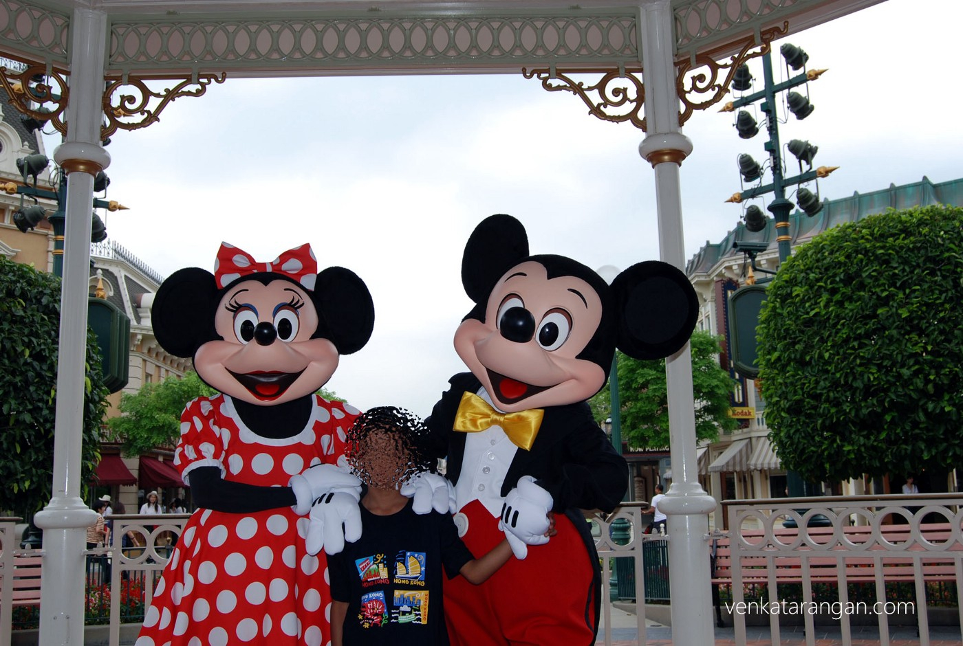 Son loved taking a picture with Mickey and Minnie