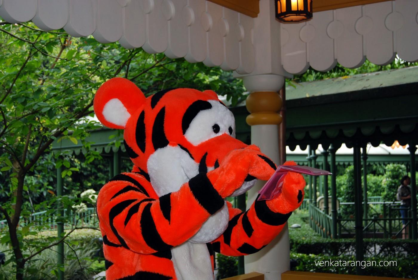 Tigger, the tiger signing his autograph