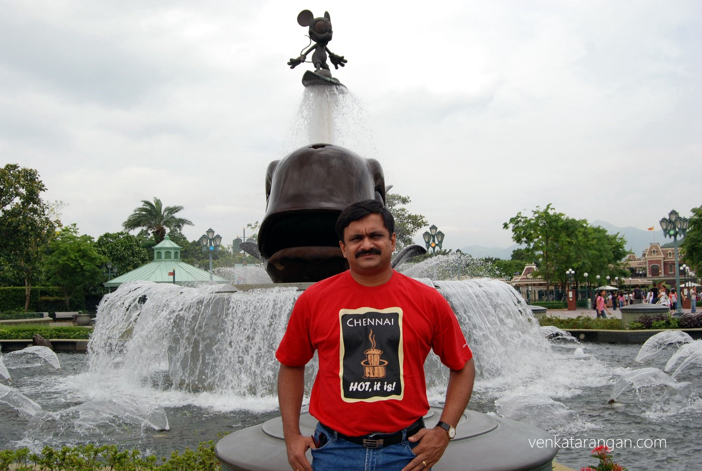 Venkatarangan in front of the Mickey Mouse surfing water fountain