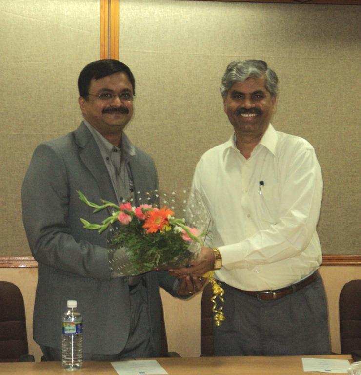 Dr.S.Shanmugavel (Registrar Anna University, Chennai) presenting a flower bouqet to T.N.C.Venkata Rangan