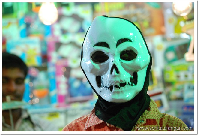 This boy (name was Raja) in a shop posed for me voluntarily with a mask