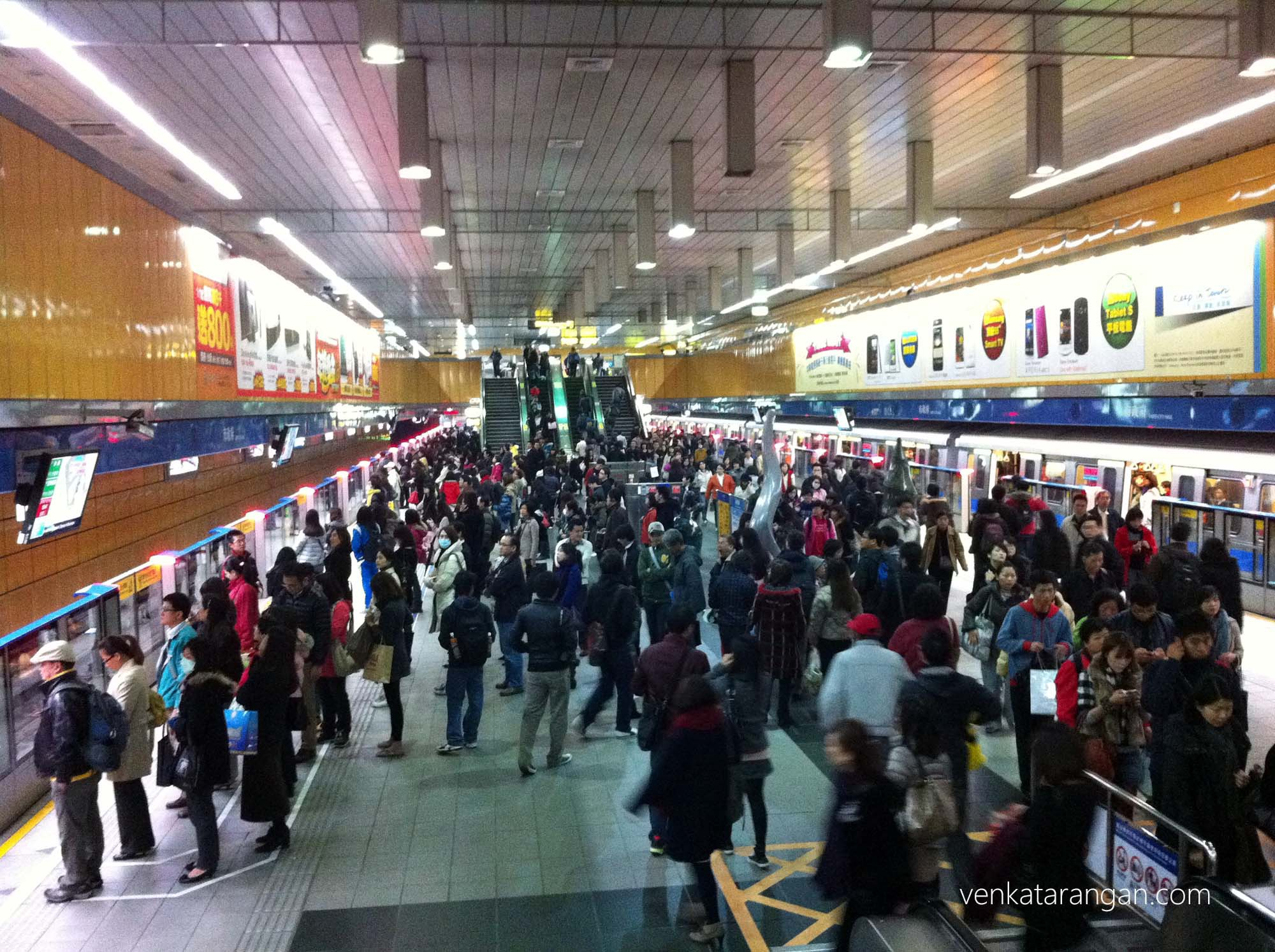 Commuters waiting for Taipei Metro