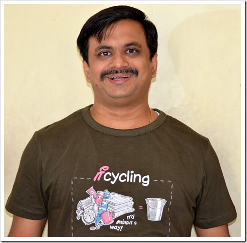 Wearing Dude Tamizha T-Shirt saying Recycling my Mom's way