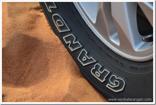 Wheel of Land Cruiser in Sands of Dubai Desert Safari