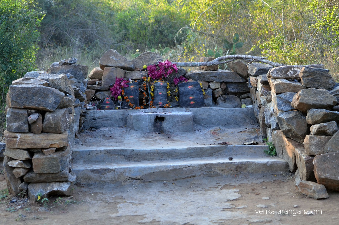 The black stones represent the Gods & Goddess, worshipped by local tribes in the area