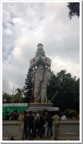 Tall Lord Hanuman deity along the downhill route)