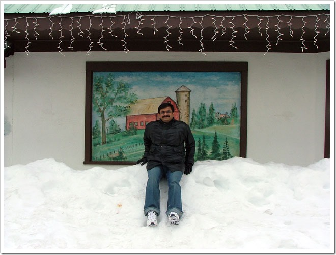 Venkatarangan playing with Snow on roadside- LeavenWorth