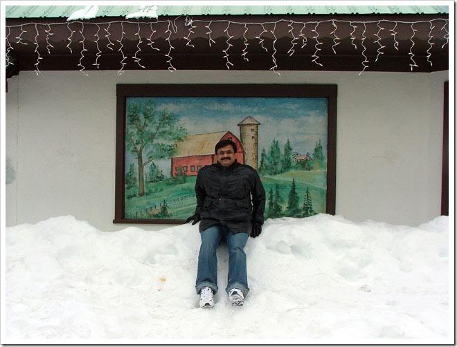 Venkatarangan playing with Snow on roadside- LeavenWorth