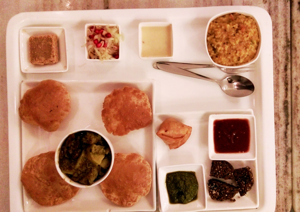 Samosa, Khichdi with kadi, Green Salad, Chutneys, Puri with subzi and Sukhdi