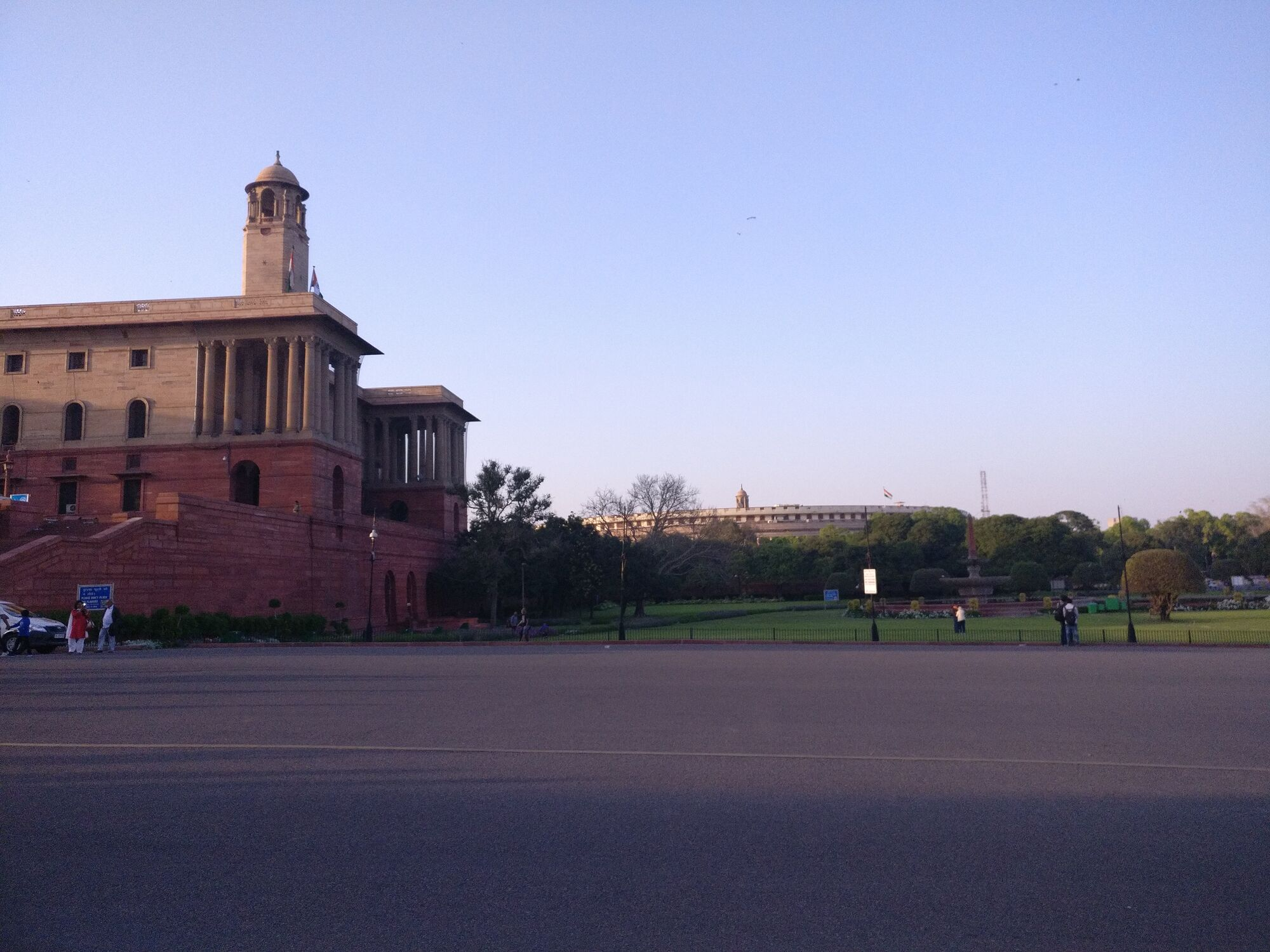 Seen here on the left is the North Block which houses the Ministry of Finance & the Home; in the distance on the right is the Parliament of India