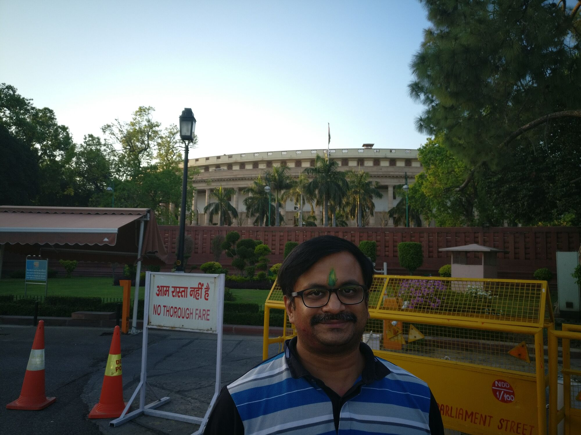 This is the closest I have gone to the seat of power in India - behind me is seen Parliament of India building.