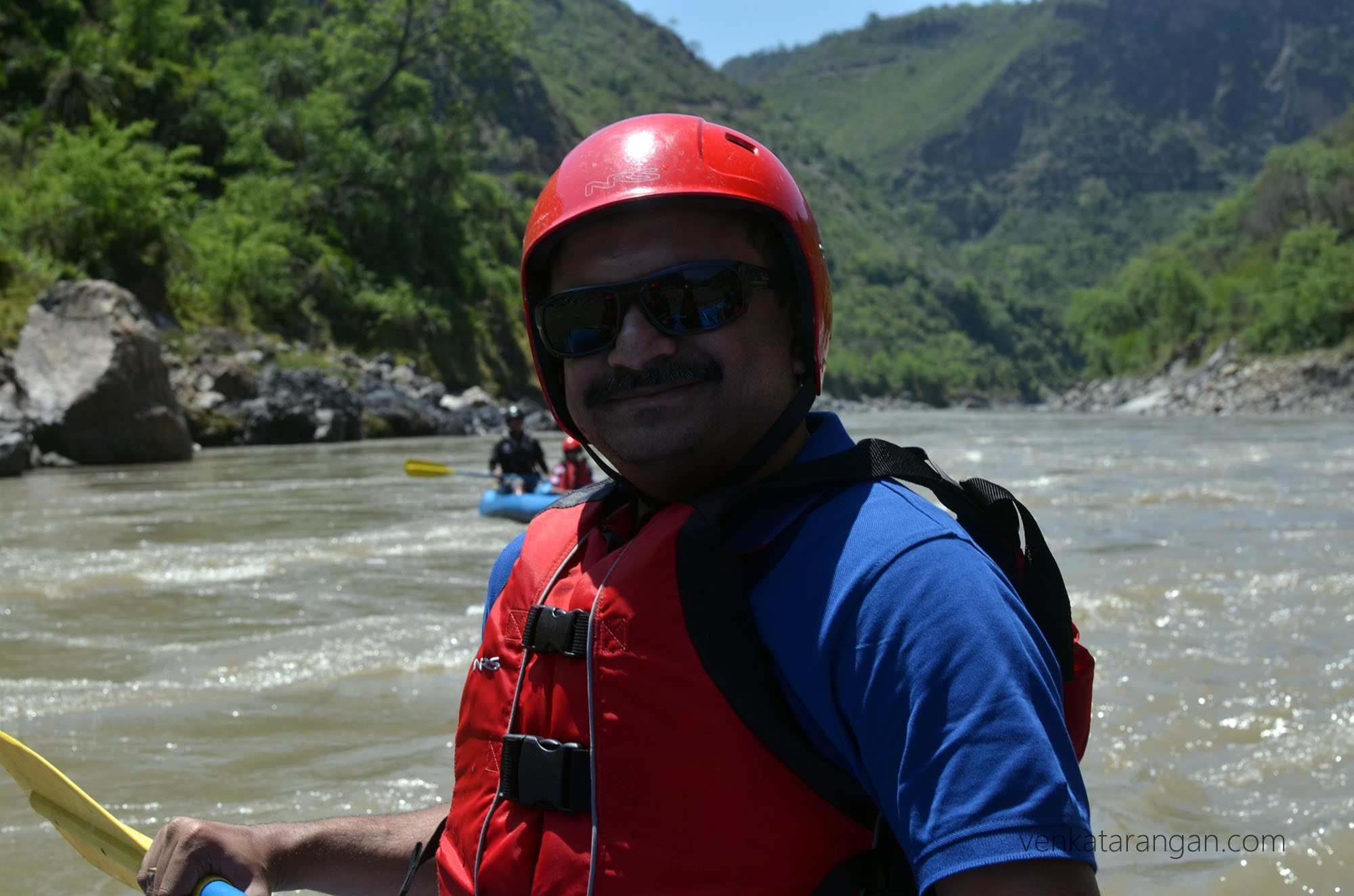 Venkatarangan paddling on a banana boat - fully strapped with safety gears