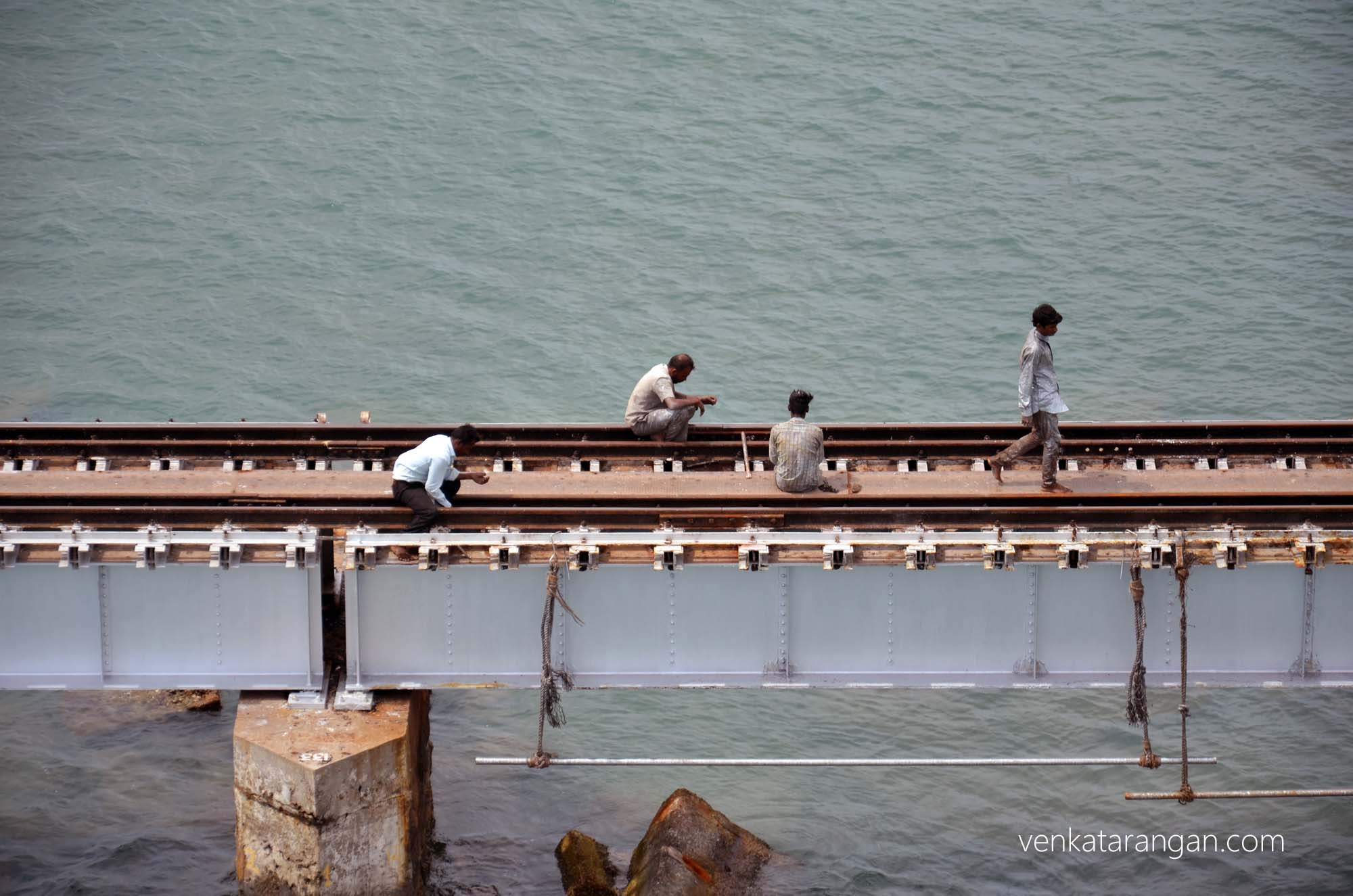 The Railway men repairing the track - Pambam rail bridge