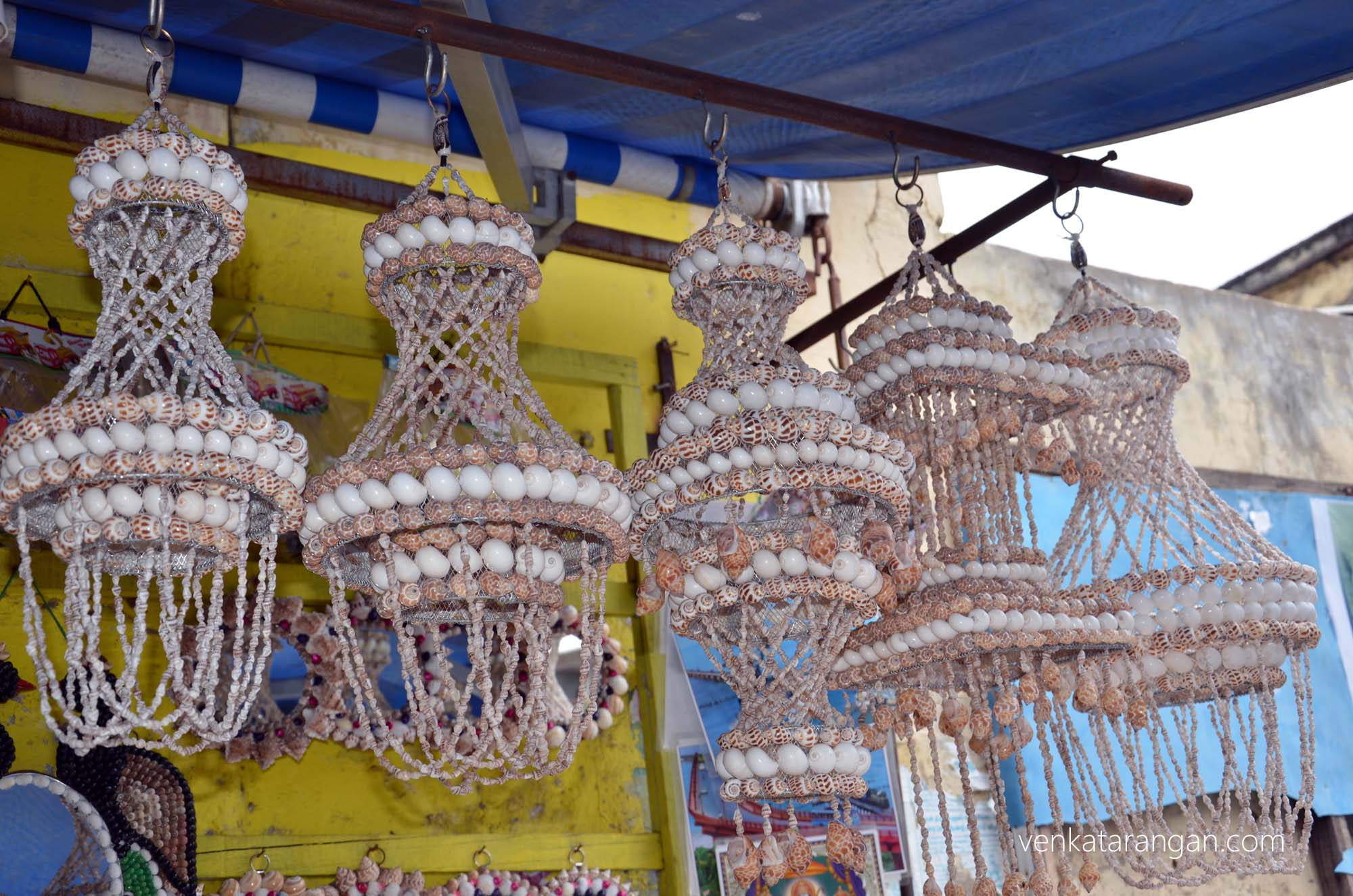 Rameswaram is famous for its handy craft items made from conch and seashells - a shop selling decorative lamp holders