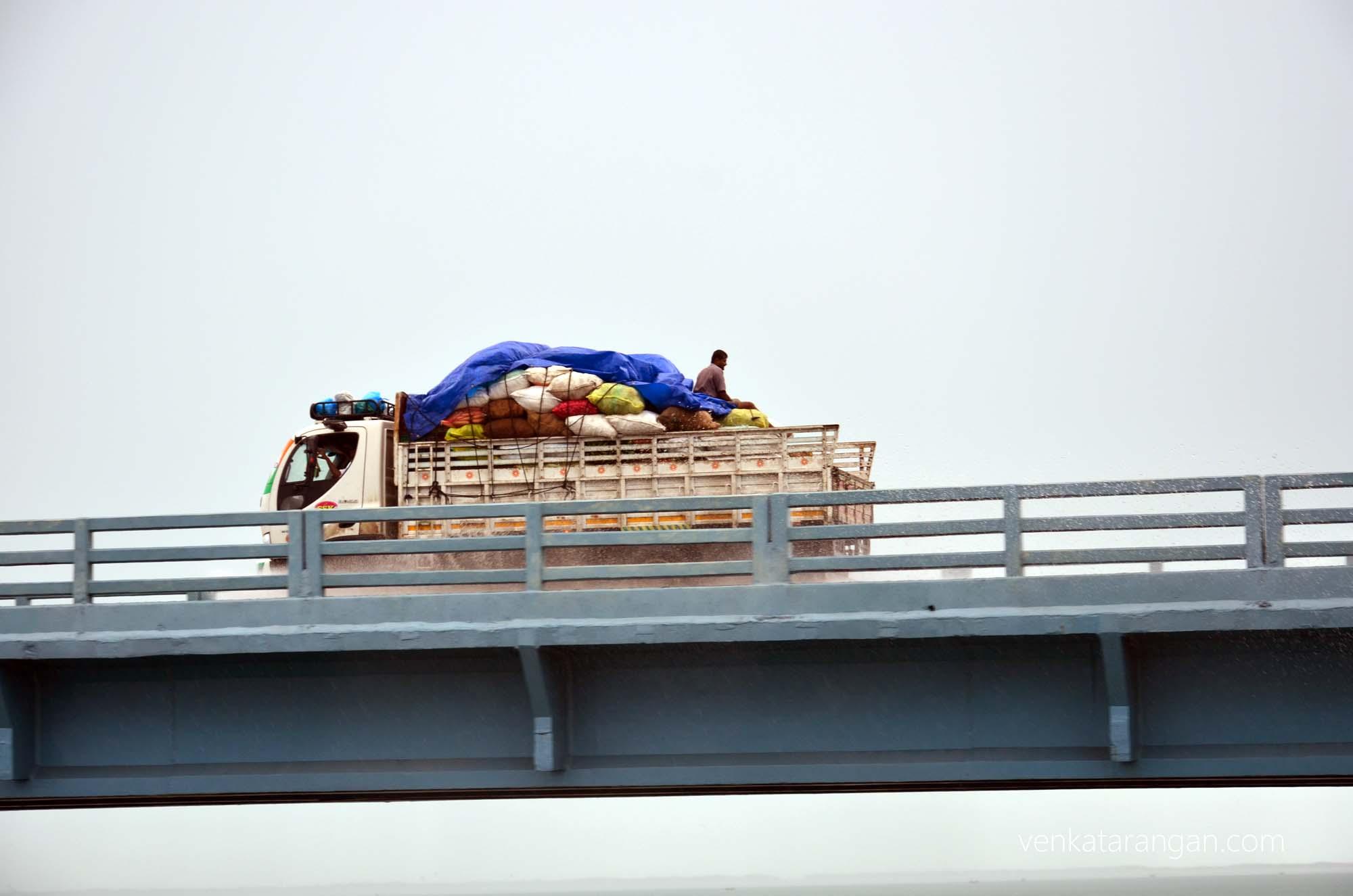 Mini truck going over the new road bridge to Pamban village