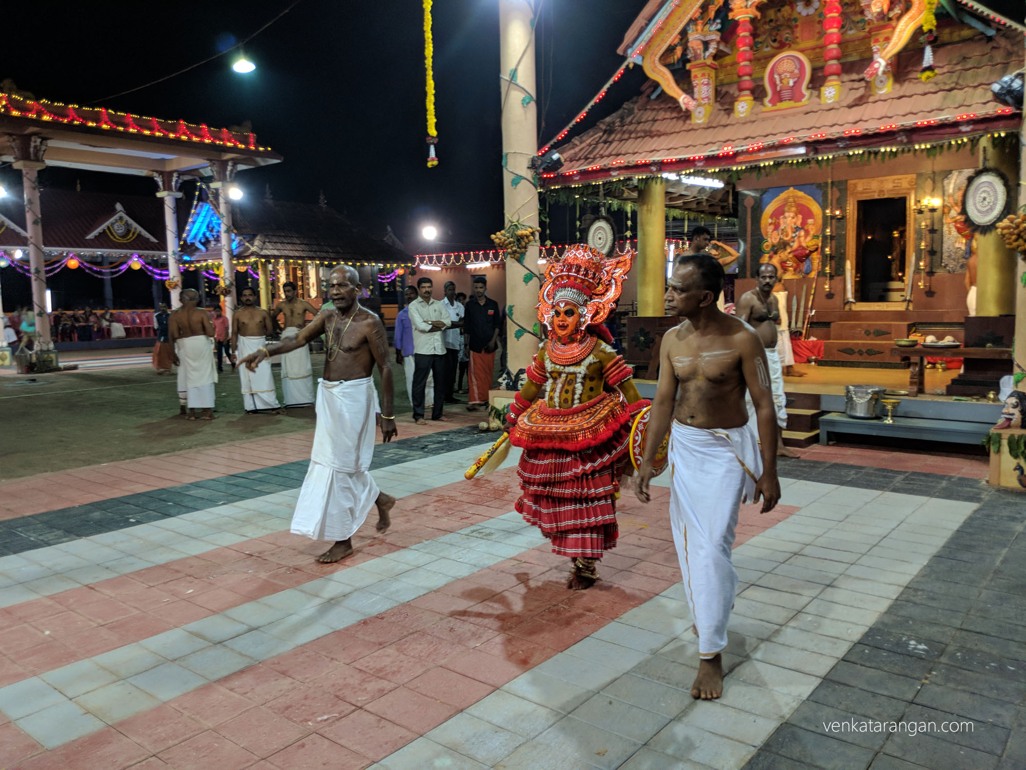 The Theyyam artist coming back after offering his prayers to the Goddess