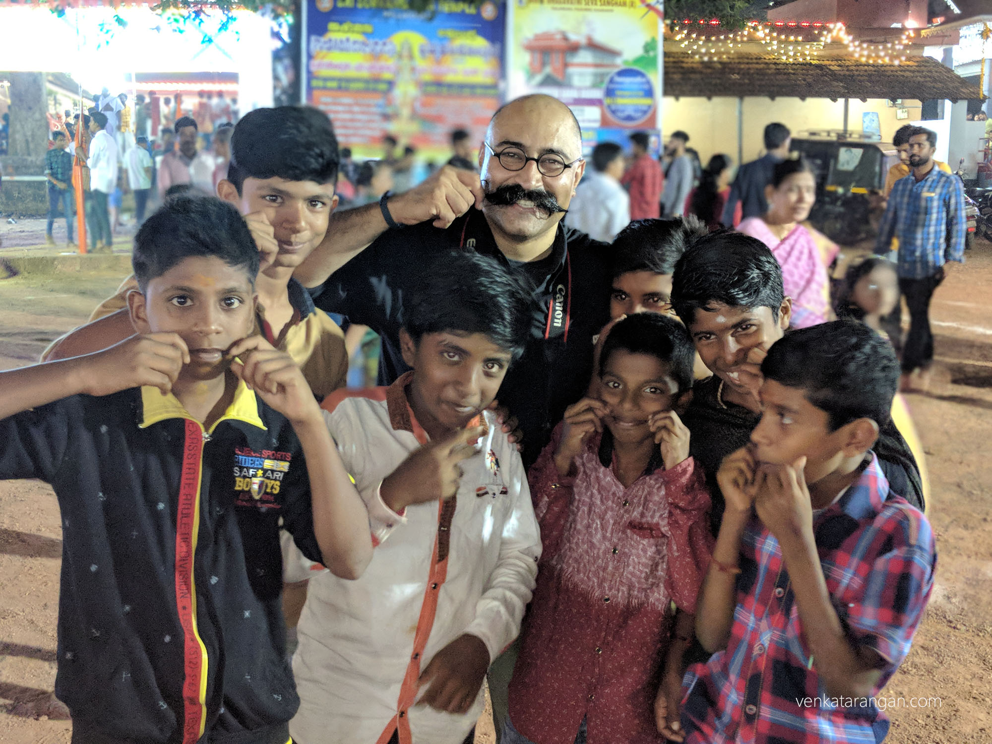 My friend Pravin Shekar showing off his moustache and attracting quite a lot of young admirers