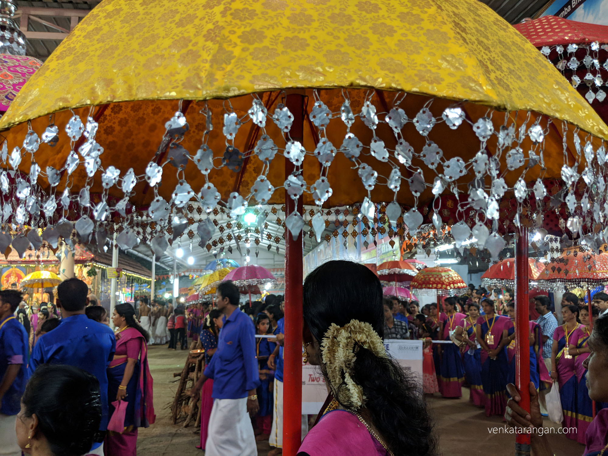 Elaborately decorated umbrellas brought as offerings to the Goddess