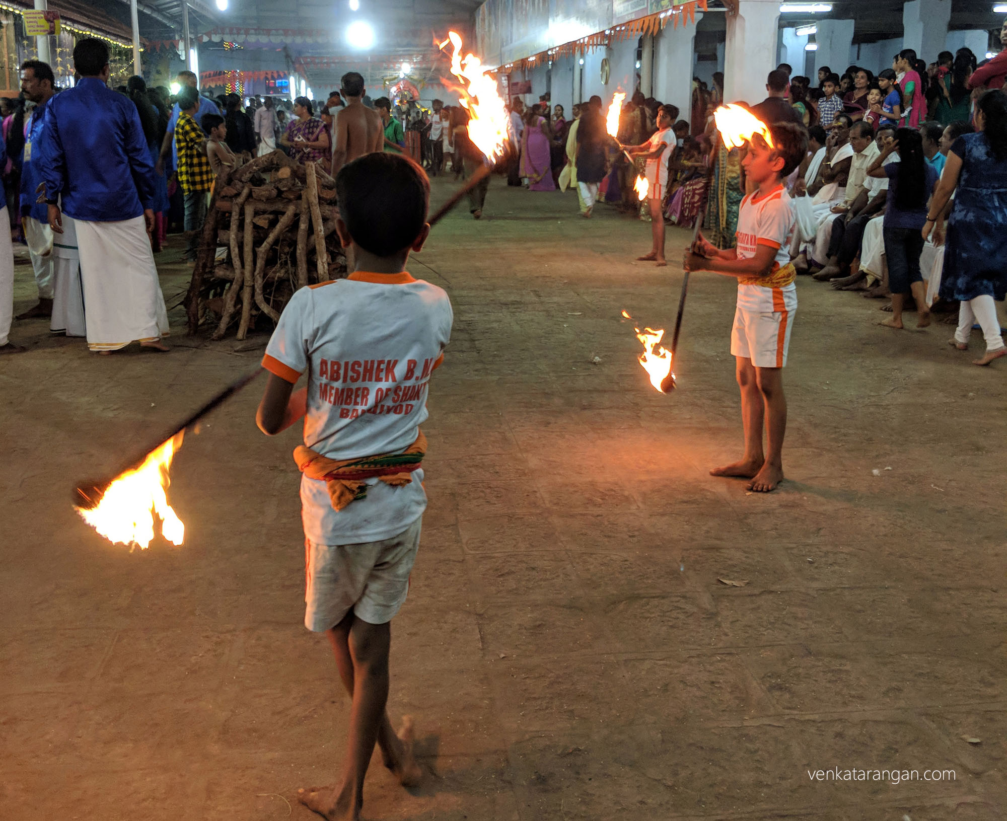 Local school kids showing their traditional self-defence art with lighted sticks