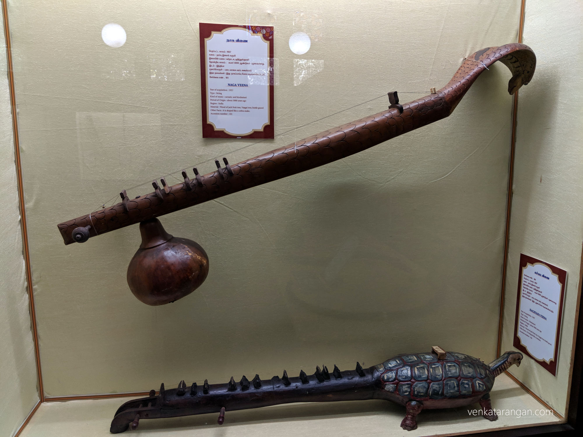 Top-Naga Veena (நாகை வீணை). The wood of jackfruit tree, Vaagai tree, bottle gourd tree.Shaped like a cobra snake. Bottom-Kachyapa Veena (கச்யப வீணை). Shaped like a tortoise.