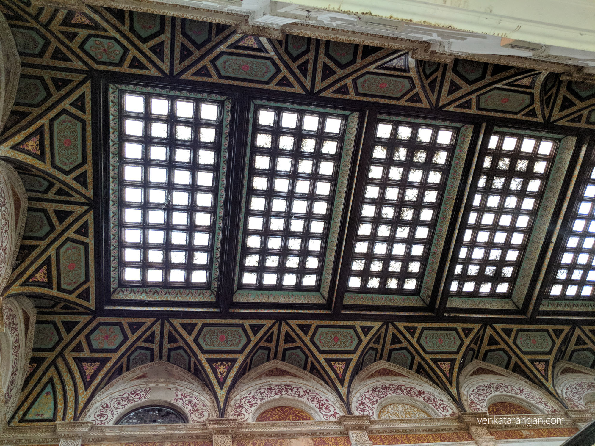 Intricate designs and glass work on the ceiling