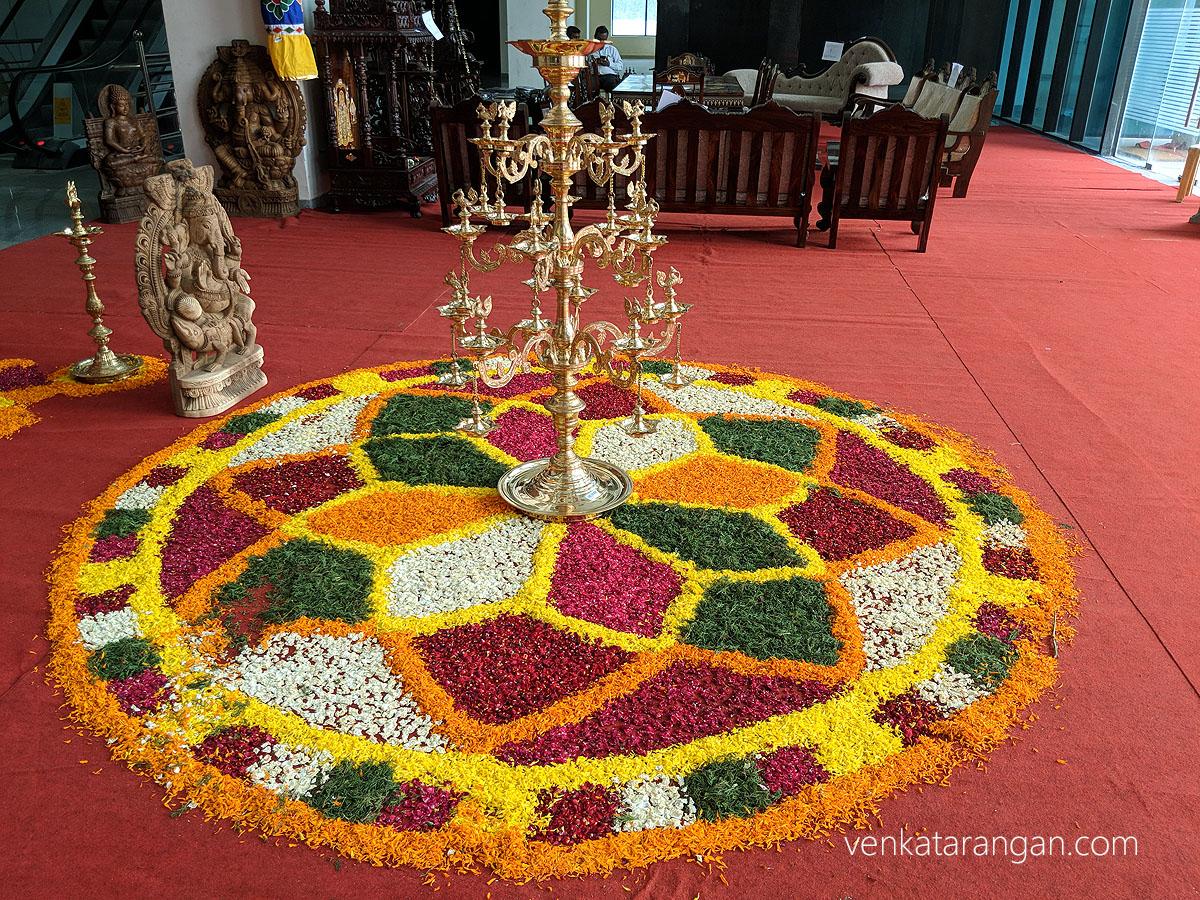 Flower decoration at the entrance - அழகான பூக்கோலம் நம்மை வரவேற்கிறது