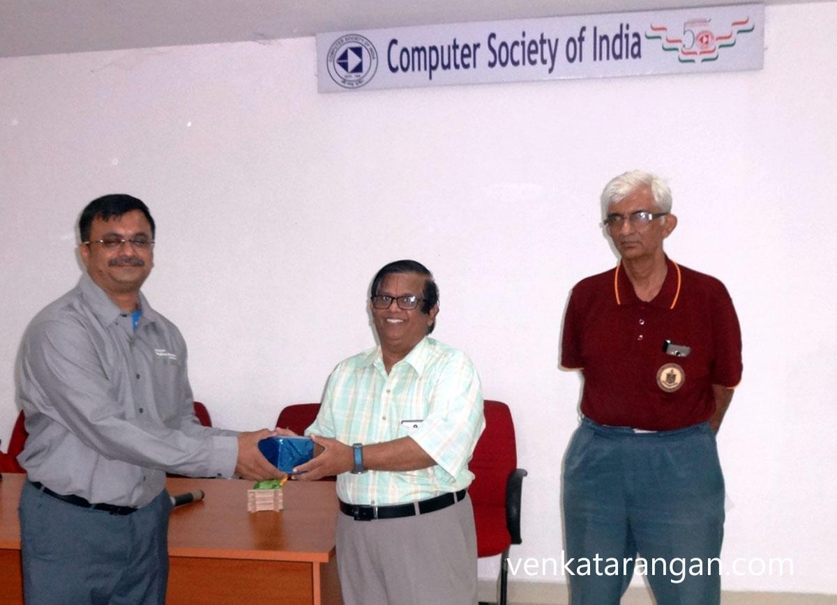 Mr H R Mohan presenting a memento