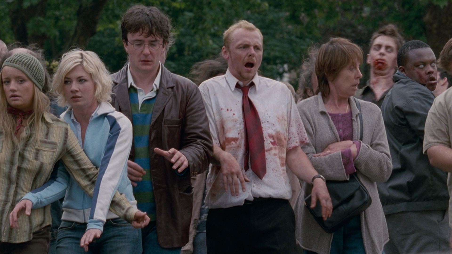 Lucy Davis, Kate Ashfield and Simon Pegg (in the centre with the red tie) in Edgar Wright's Shaun of the Dead (2004)