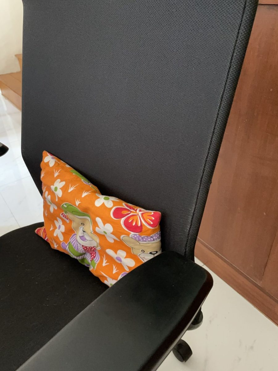 A small pillow for a firm lower back support