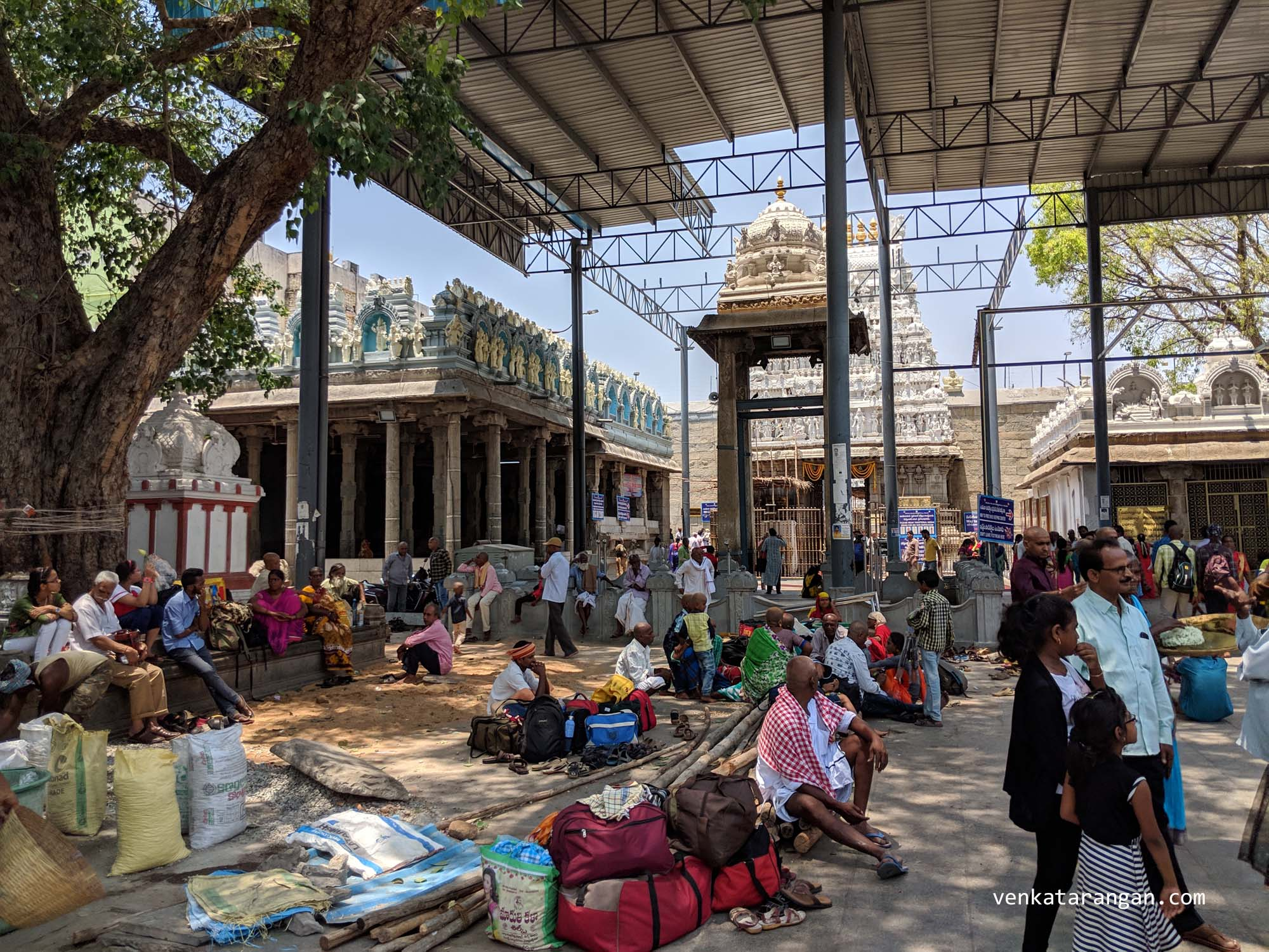 Devotees waiting outside the temple in the shade after having the darshan