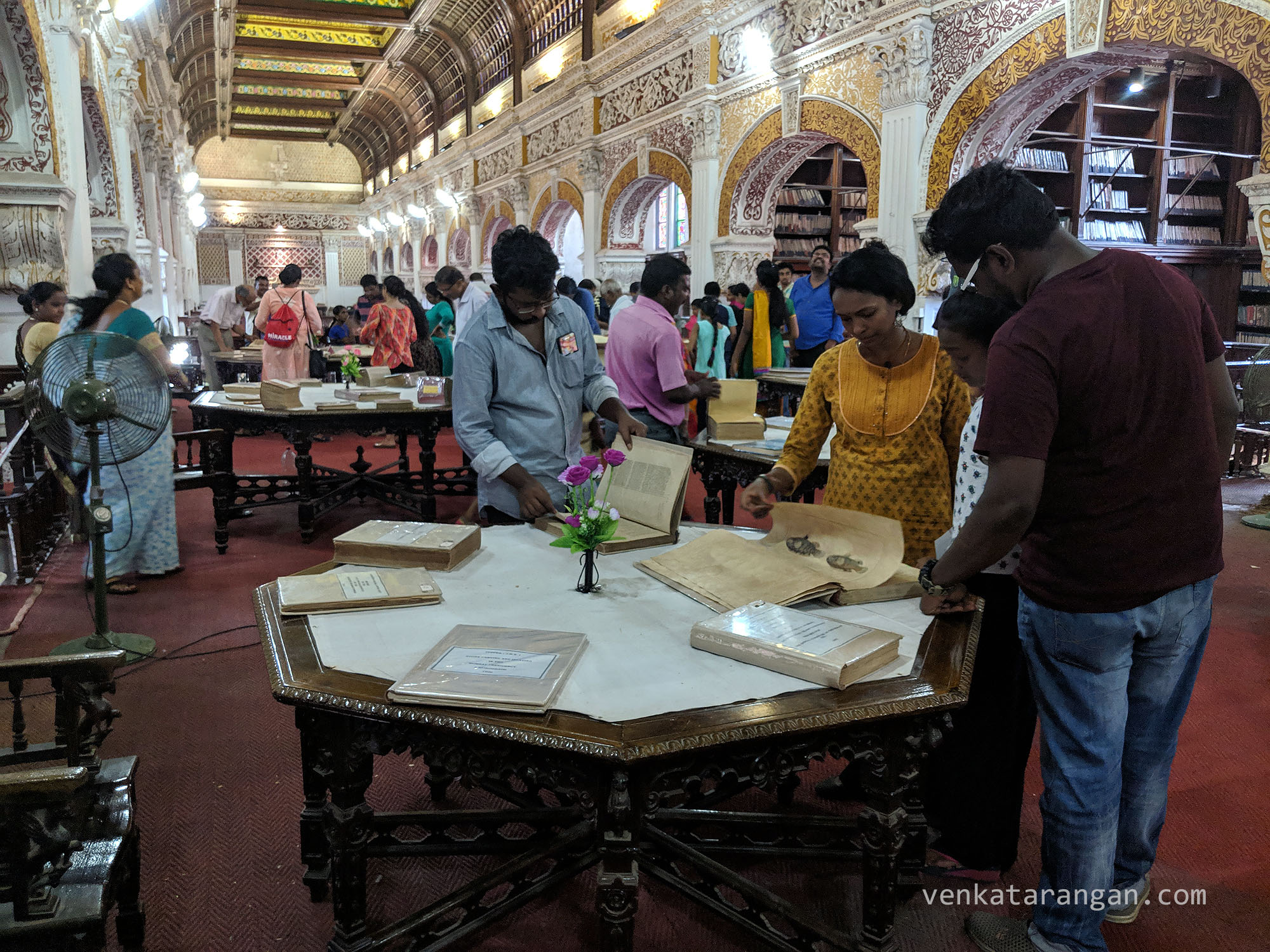 Book-lovers and visitors going through books which have not seen a public for decades