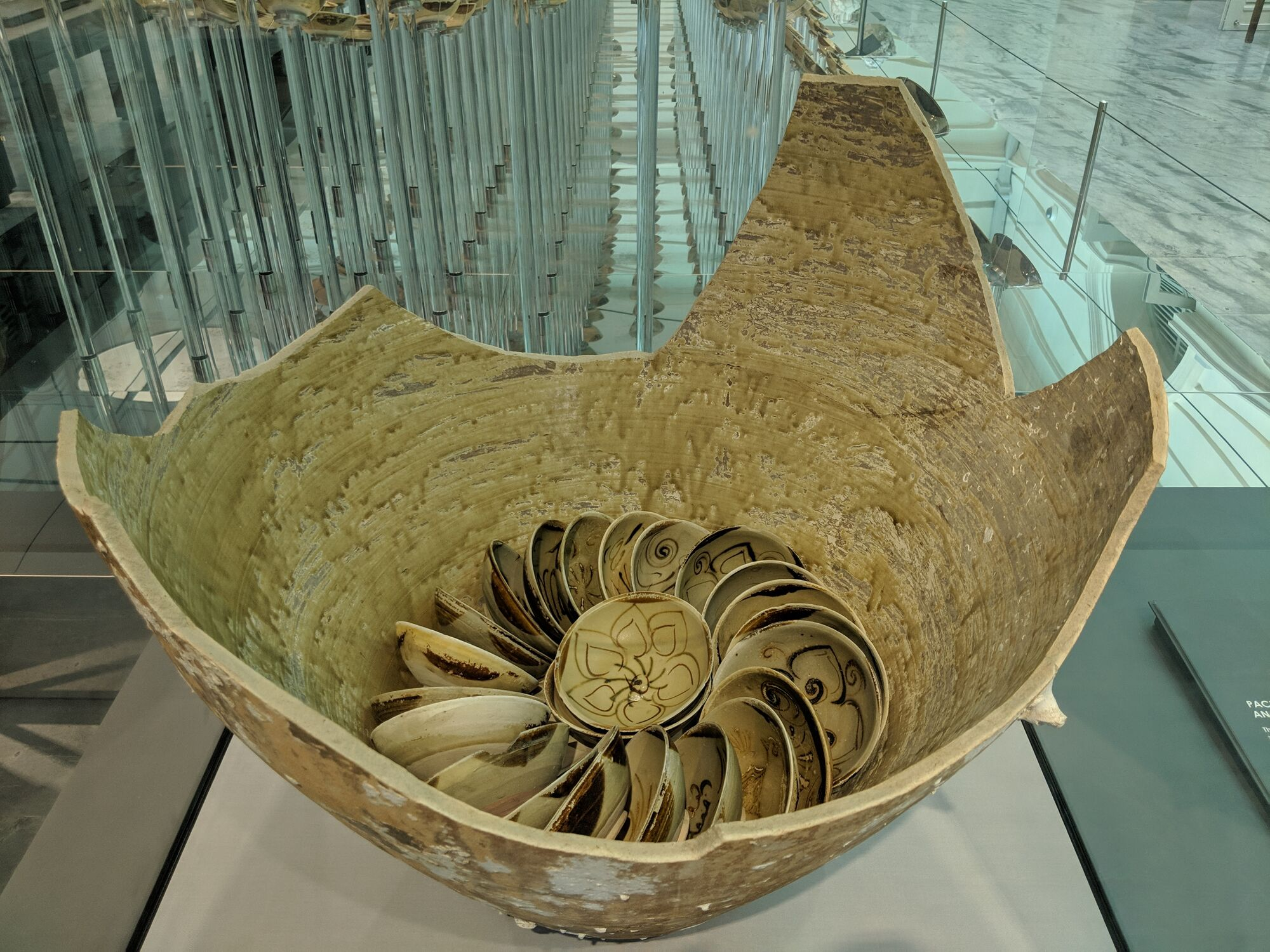 Thousands of ceramic bowls were tightly coiled inside storage jars. About 130 bowls were packed in each jar, cushioned by straw.