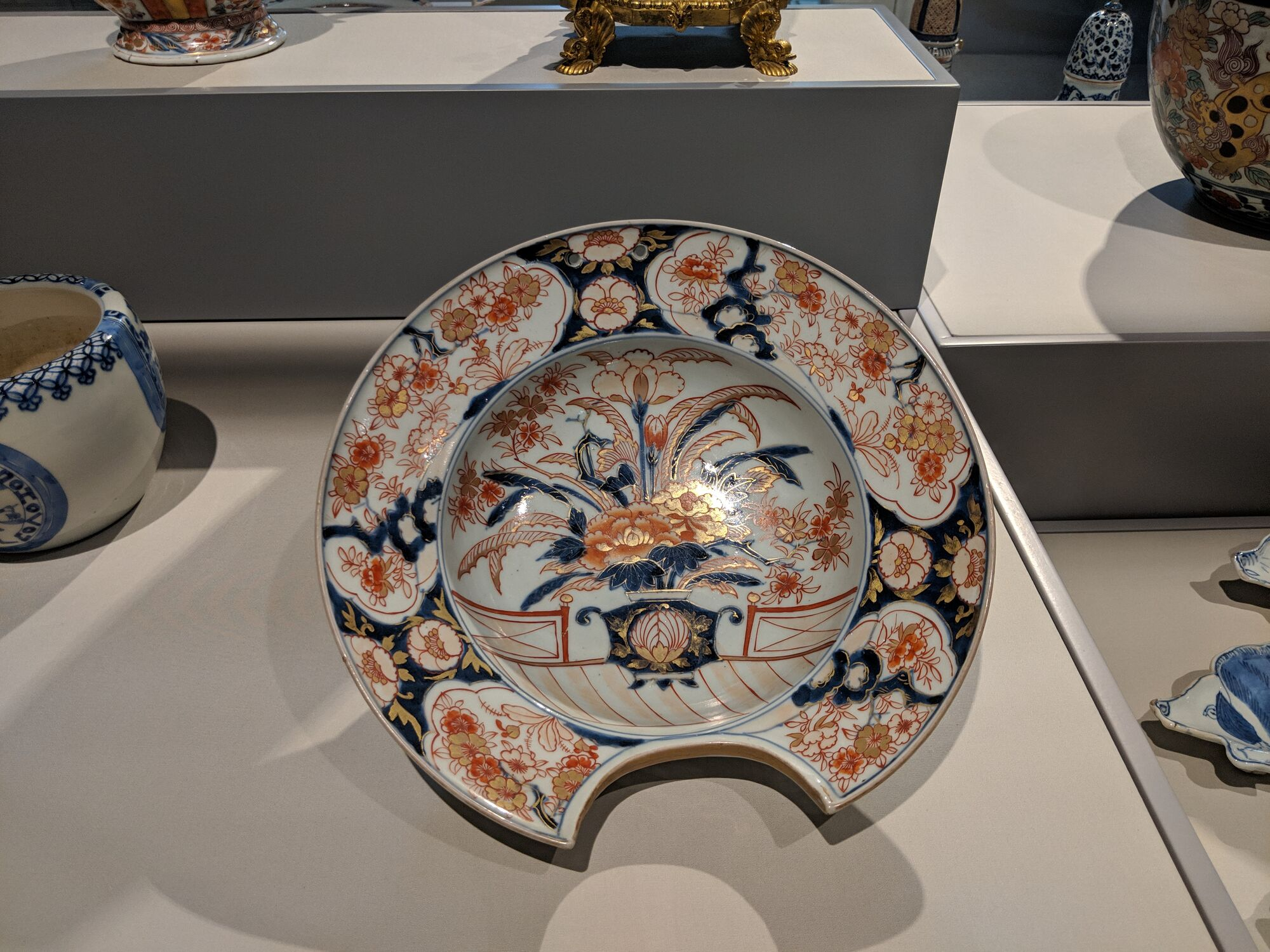 Shaving Basin, Japan, Arita Kilns, early 1700s, Porcelain. Fits under the catch water and lather when shaving.