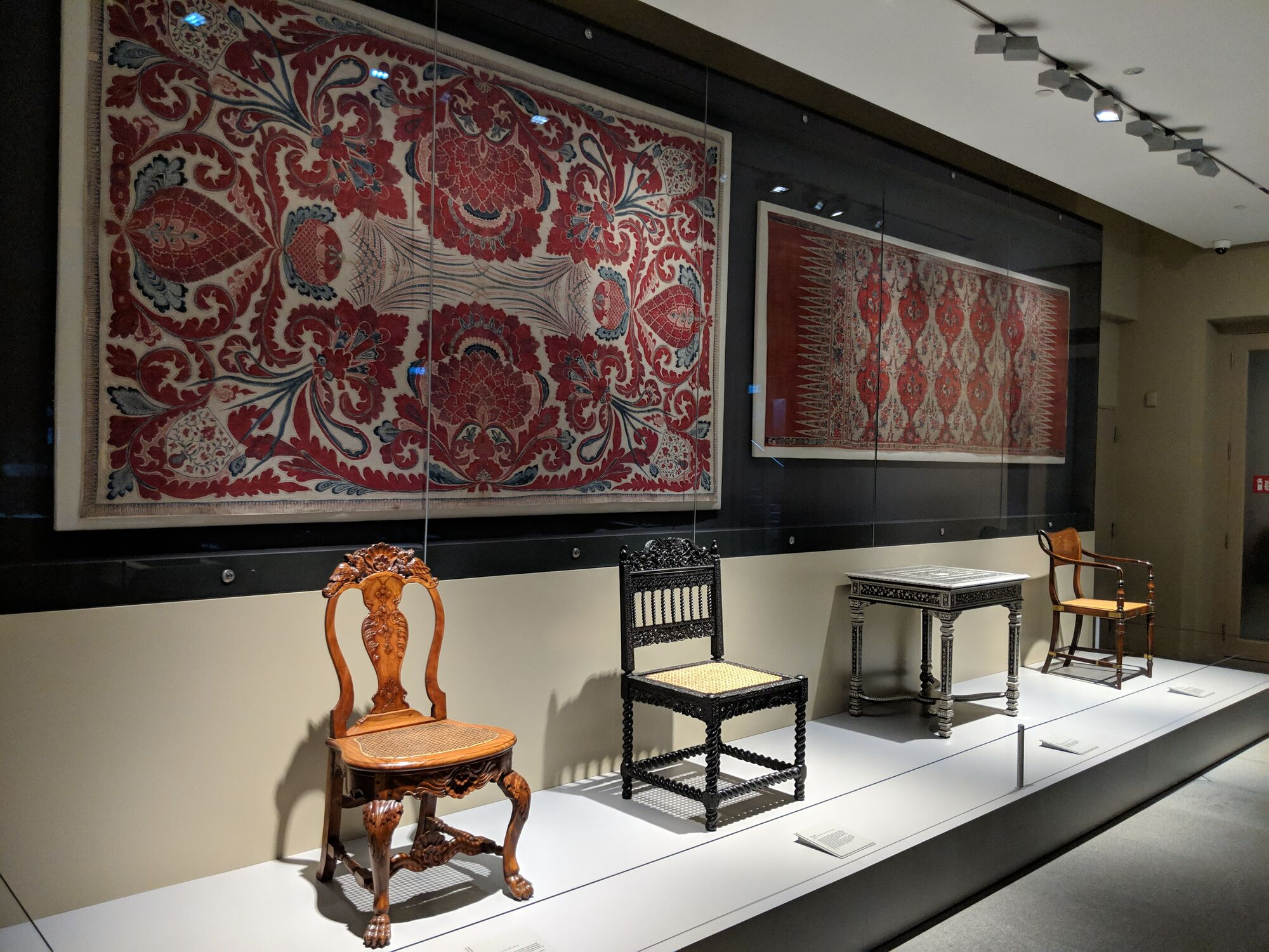 1) Raffles chair, Java or Kolkata around 1810s. 2) Table, India, Vizagapatam, intricately inlaid with ivory. 3) Side chair, India, Coromandel Coast, late 17th century, Ebony wood. 4) Cotton Textiles - Hanging with the tree of life, 17th or 18th century.
