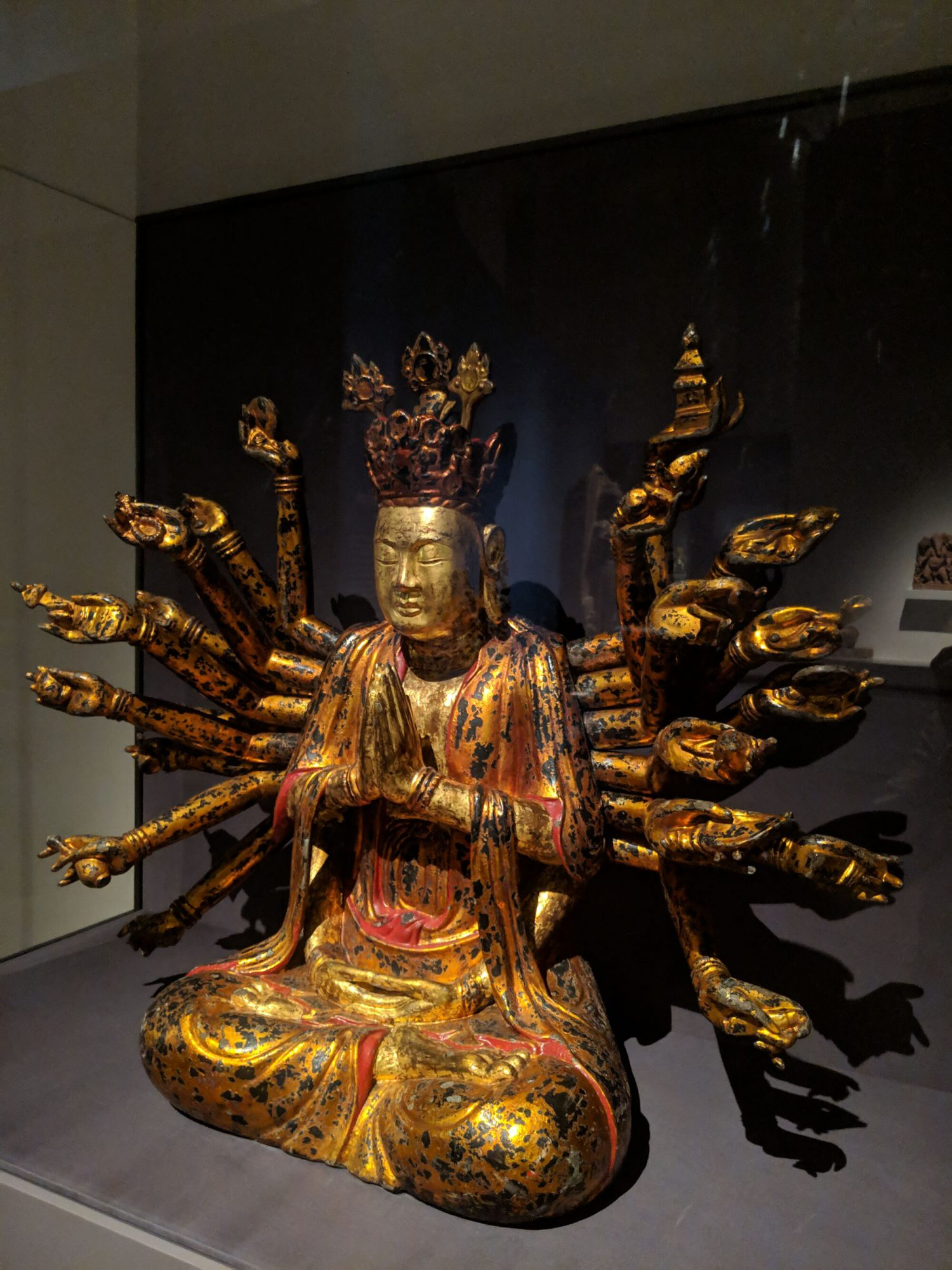 Cosmic form of Quan Am, this multi-armed figure represents Quan Am (Bodhisattva Avalokiteshvara's name in Vietnam) with 1000 hands and 1000 eyes.