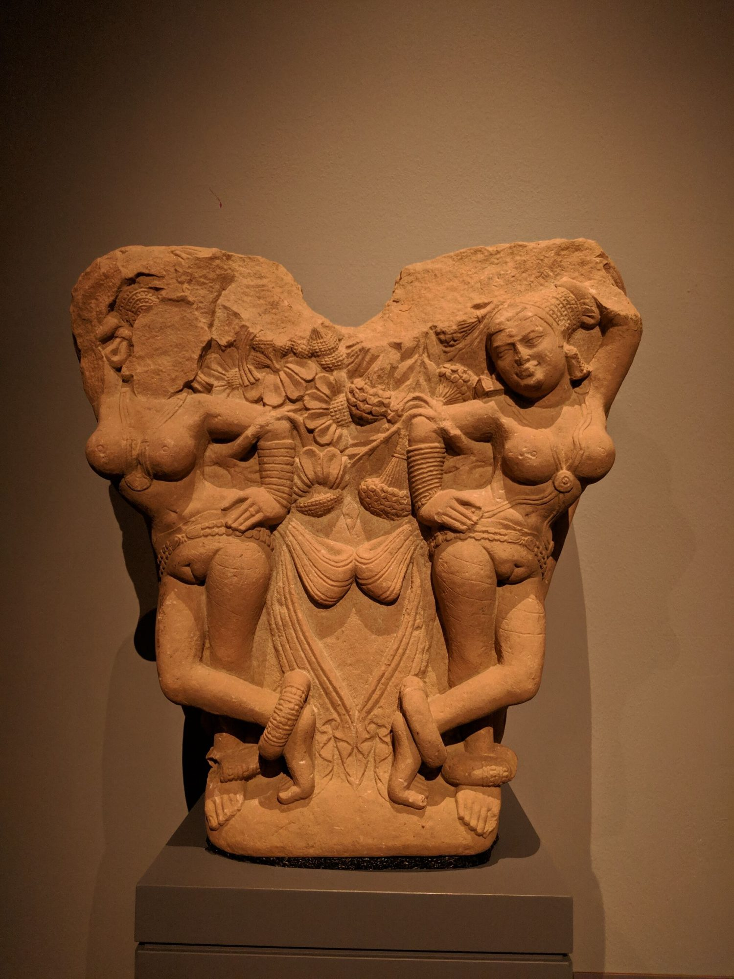Gateway bracket with four shalabhanjikas, Northwest India, 2nd century, Sandstone, this bracket depicts pairs of young women on either side of a tree. They are female nature spirits and fertility symbols.