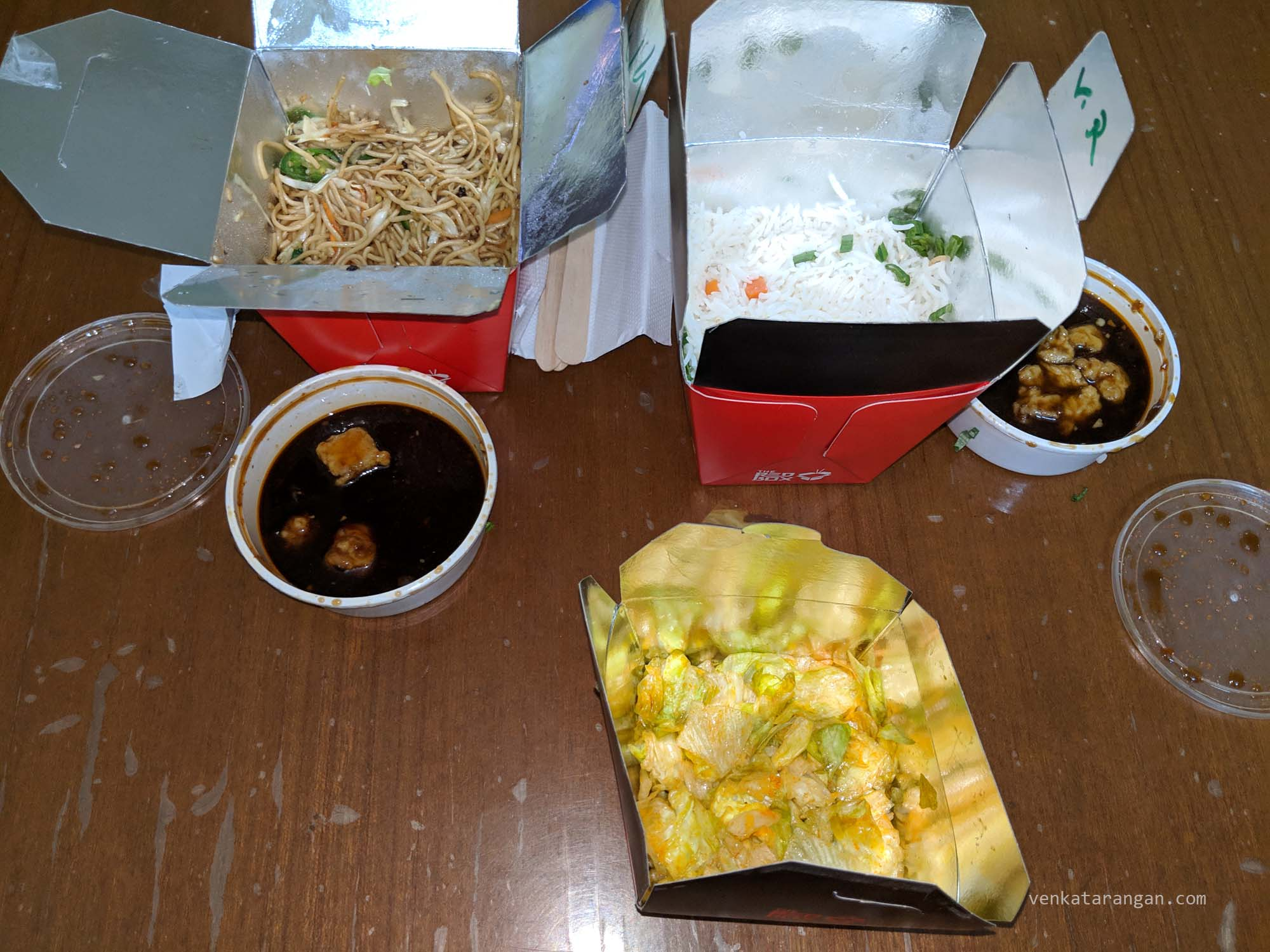(Clockwise from left) Veg Chilli Garlic Noodles with Kung Pao Paneer, Veg Fried Rice with schezwan cauliflower, and, Thai Lettuce Salad.