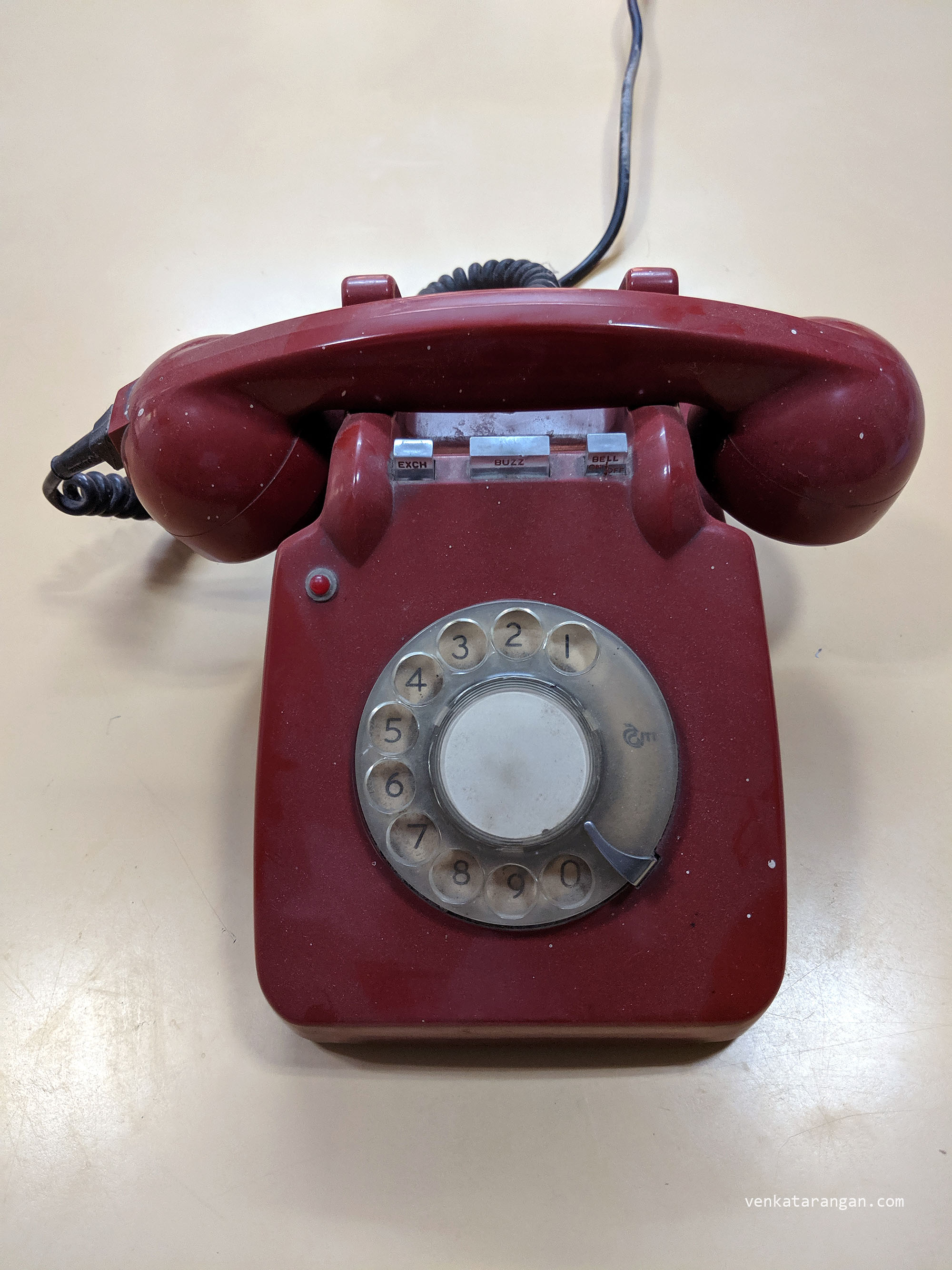 Red colour, rotary dial phone made by ITI, Government of India