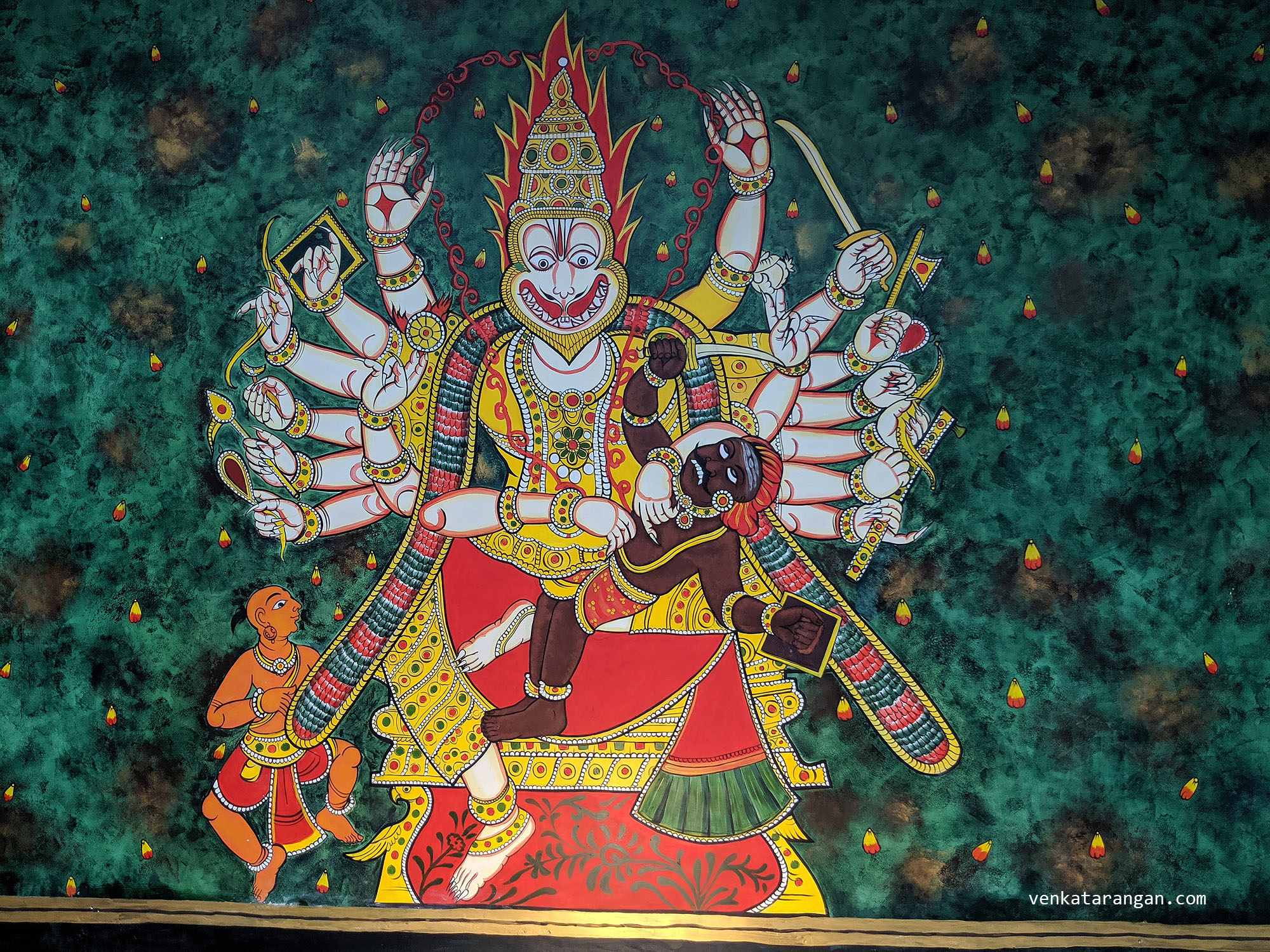 Dasavaratharam - 4. The Narasimha (The half lion and The half human) is represented by a hand-painted mural. The mural is just feets away from the main entrance equidistance from the outside and the inside as in the mythology.