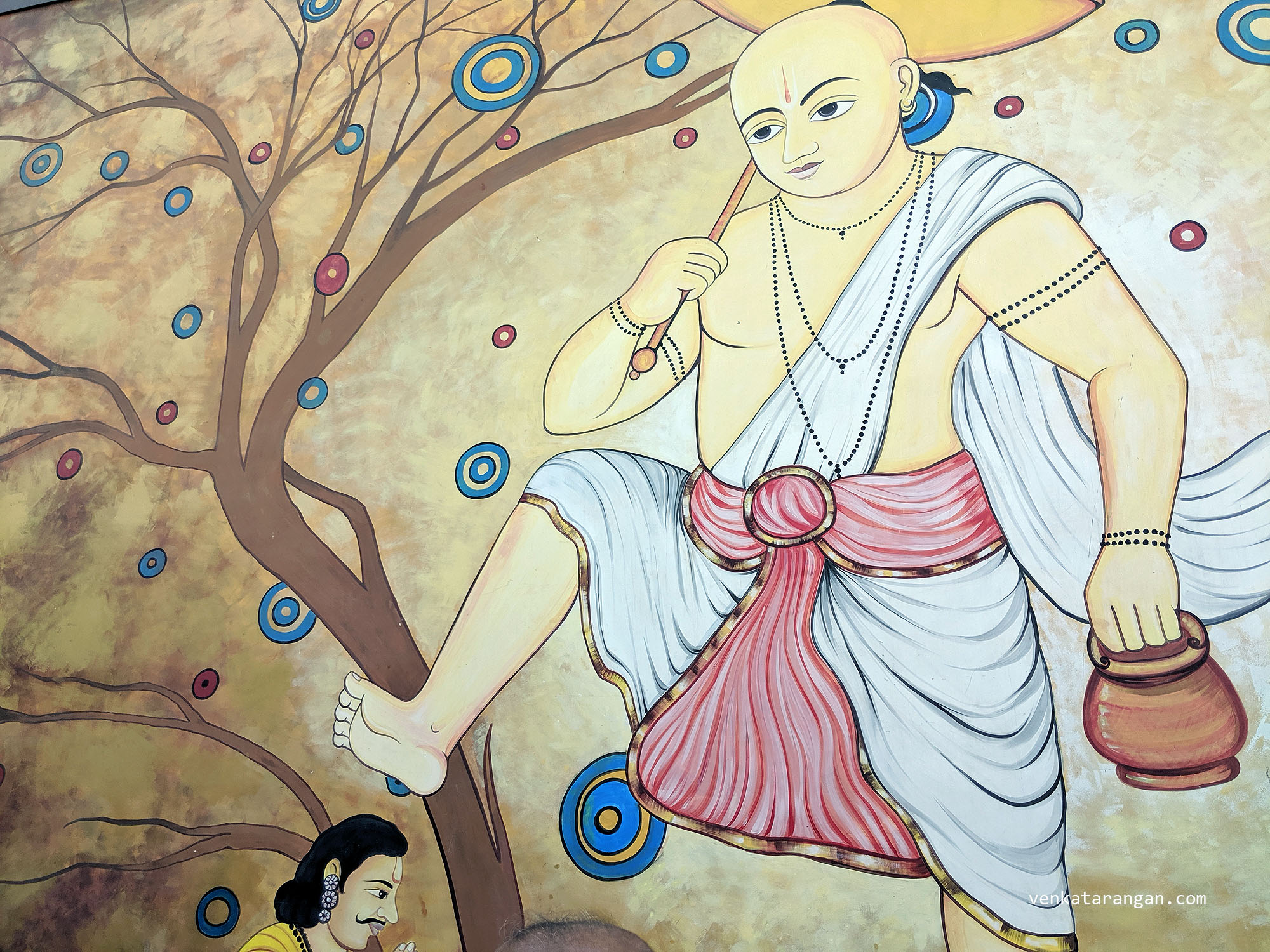 Dasavaratharam - 5. The Vamana (The Dwarf) is shown by a mural that is 15 feet in height that depicts the moment when Mahabali offers his head to the lord.