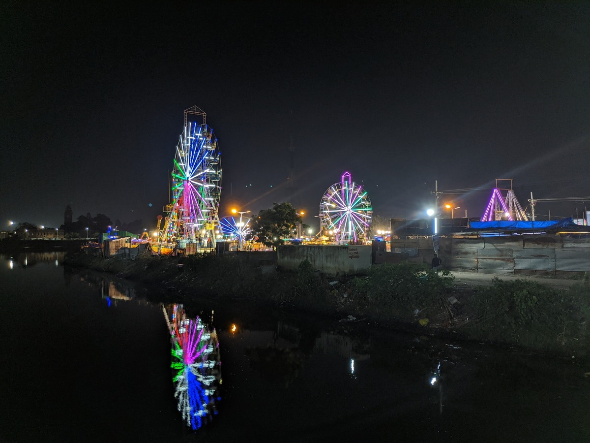 Night view across River Cooum of the rides like the Giant wheel