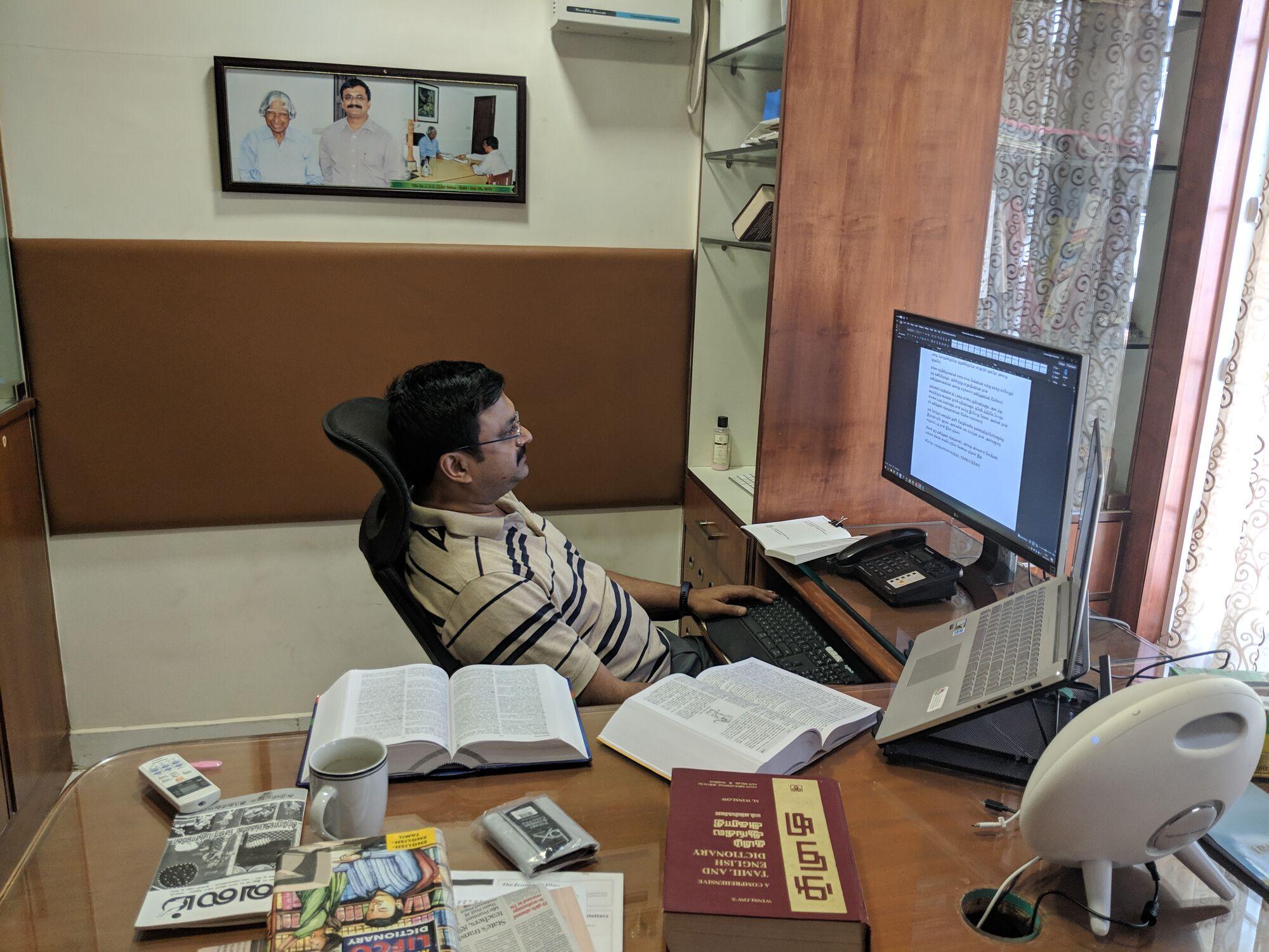 Venkatarangan reading on his desk