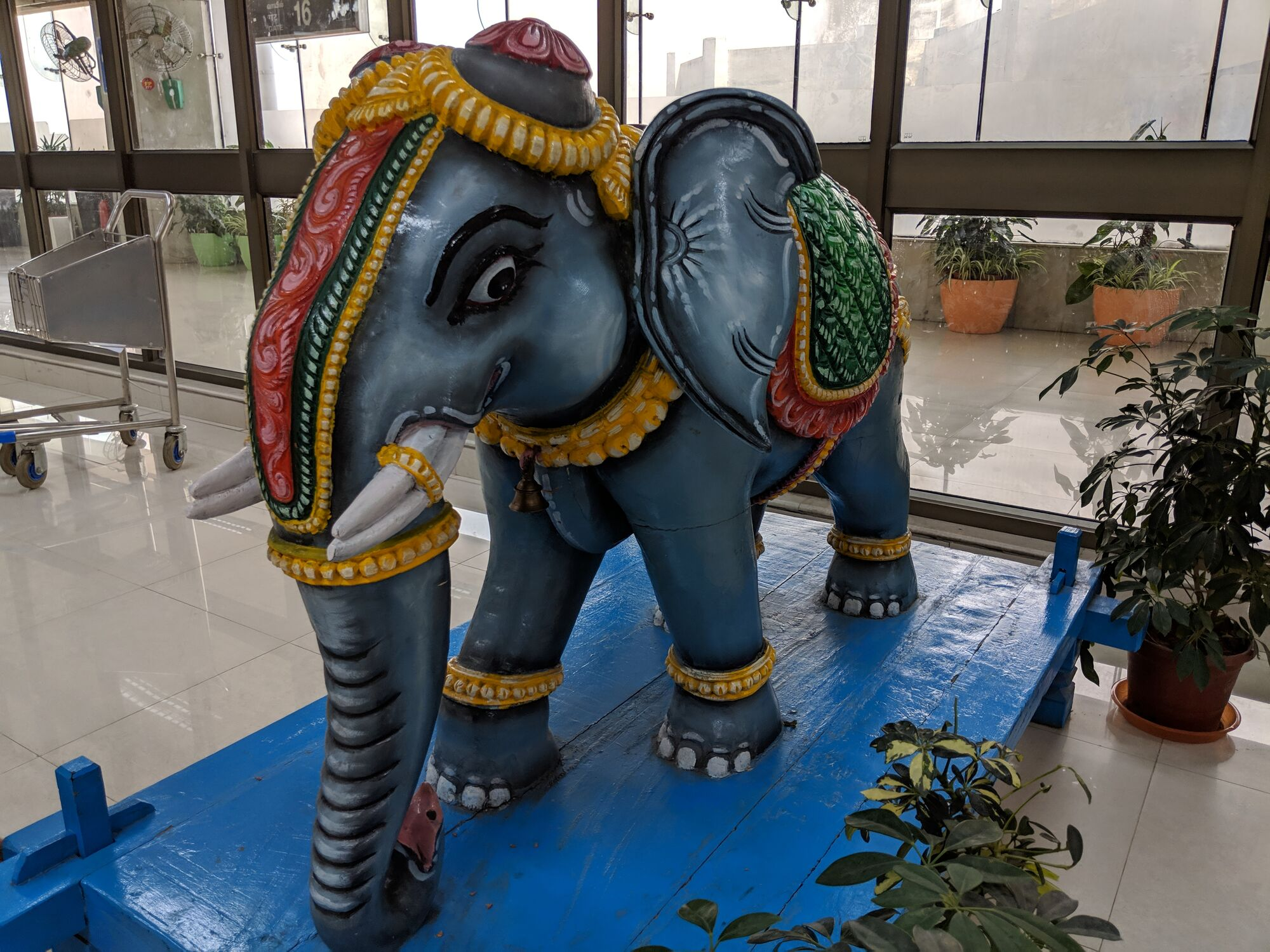 A beautifully coloured statue of a young elephant