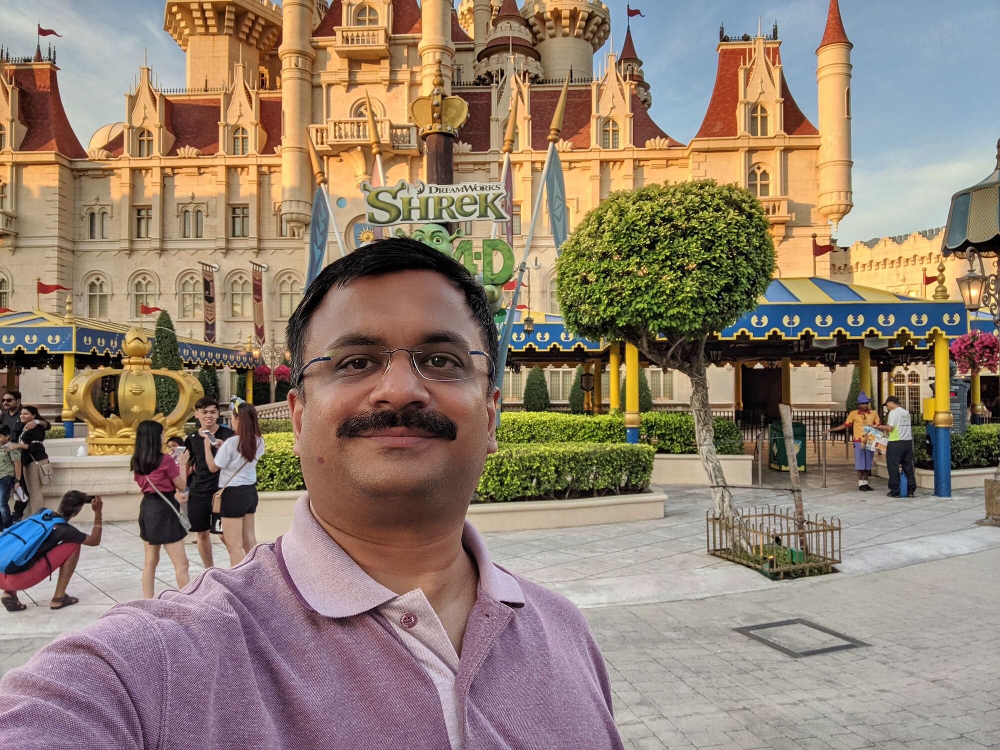 Venkatarangan in front of the Dreamworks Shrek castle