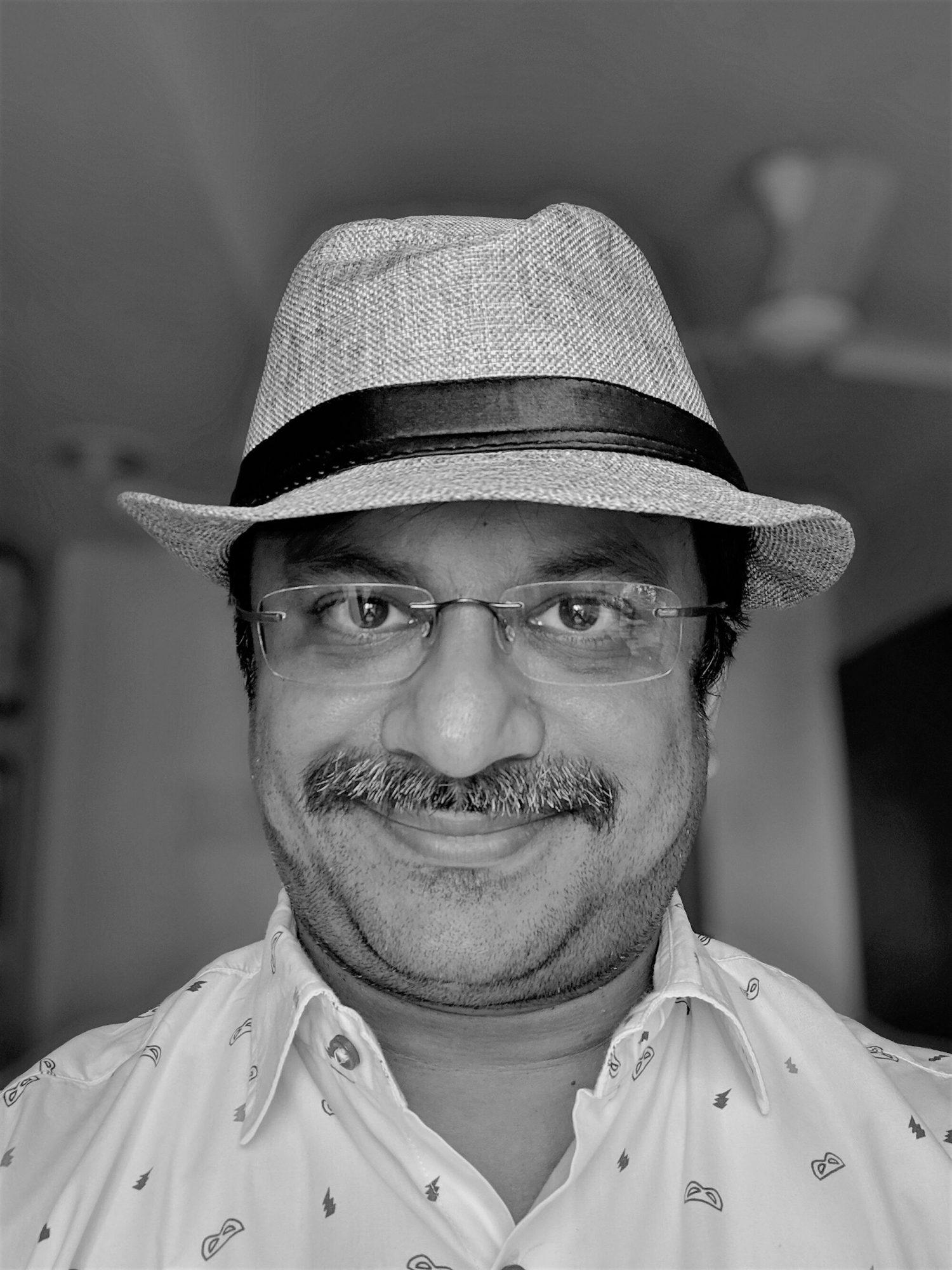 Venkatarangan with a fedora hat