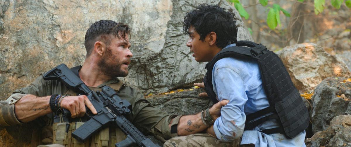 Chris Hemsworth as Tyler Rake, and Rudhraksh Jaiswal as Ovi Mahajan