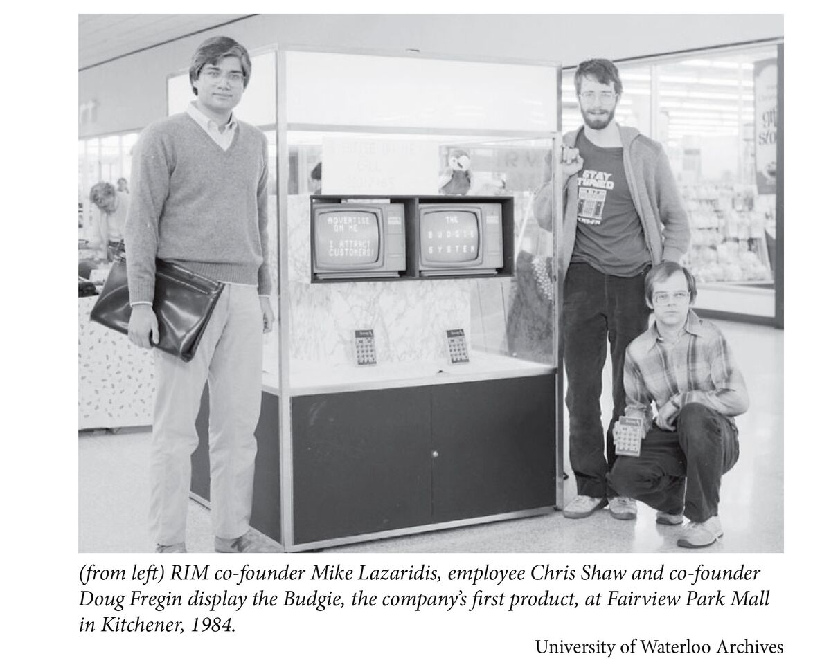 RIM co-founder Mike Lazaridis, employee Chris Shaw and co-founder Doug Fregin display the Budgie, the company's first product, at Fairview Park Mall in Kitchener, 1984.