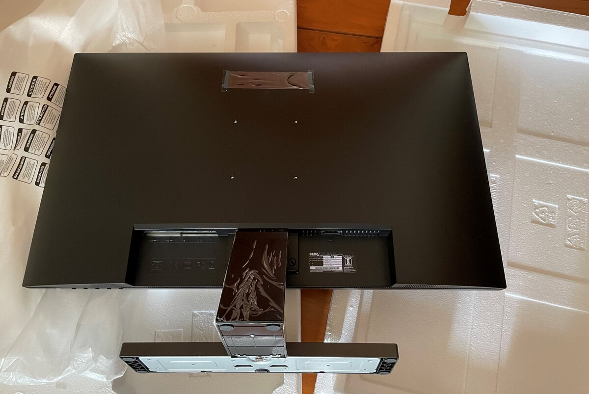 The backside of BenQ EW3270U, fixed stand. The ports are facing down.